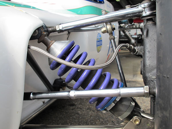A thin Faulkner helper spring prevents the main spring from rattling loose when the suspension is at full droop.