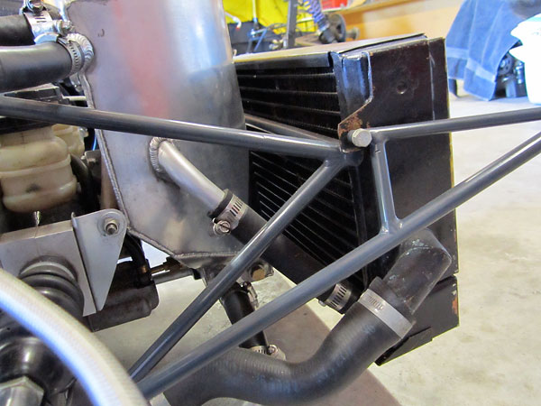 An oil cooler is integrated into the radiator assembly.