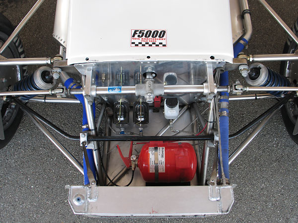 Dual Wilwood high-volume aluminum master cylinders, with bias bar, running Motul brake fluid.