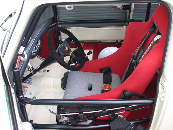 Cobra racing seat (recovered to match other interior trim.)