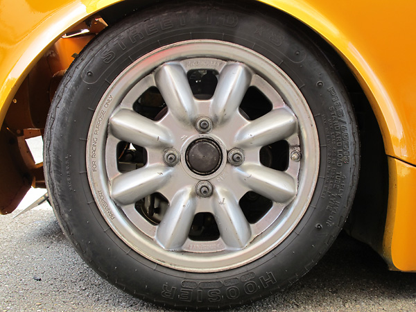 Panasport Racing 13x6 aluminum wheels and Hoosier Street T.D. *S P185/60D13 racing tires.