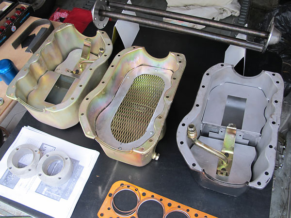 Two styles of Sports & Imports wet sump oil pans.
