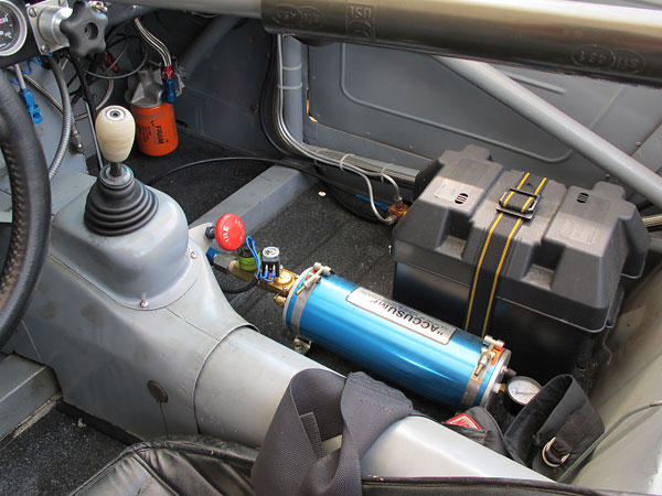 This Accusump oil accumulator is electrically actuated from a toggle switch on the dashboard.