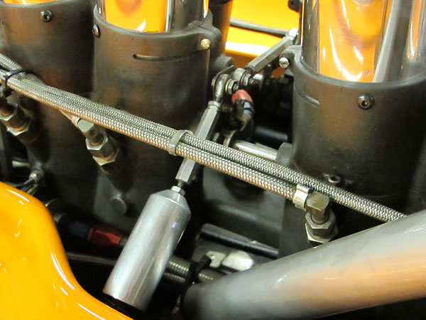 Throttle linkage, attached to MacKay fuel injection throttle bodies.