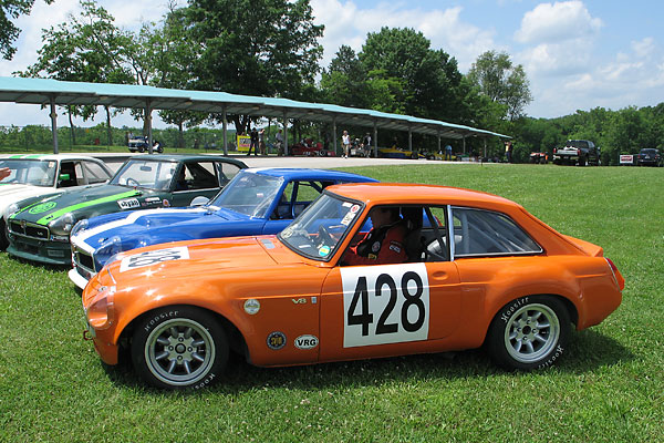 Storm's car lined up with three other MGB GT V8 racecars at Virginia International Raceway in 2009.