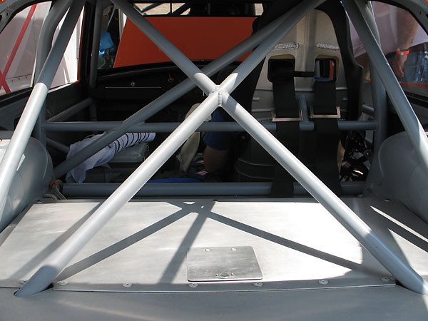 The X-shaped rollcage brace can be unbolted to facilitate removal of the fuel cell.