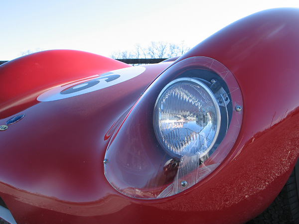 Molded perspex headlamp covers.