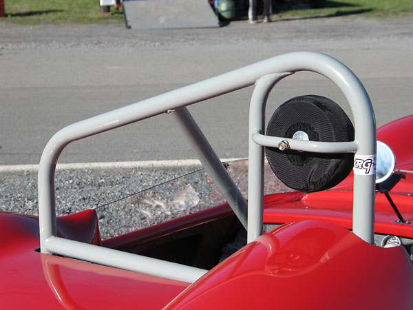 The well-braced rollover hoop and headrest are modern additions, as required for vintage racing.