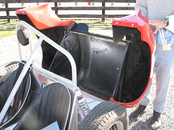 The tail contains sufficient room for the carrying of a spare wheel and still leaves room for adequate luggage space to conform with F.I.A. Appendix C requirements.