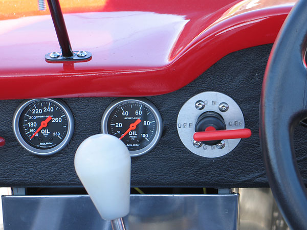 Autometer Sports Comp oil temperature gauge (140-280F) and oil pressure gauge (0-100psi).