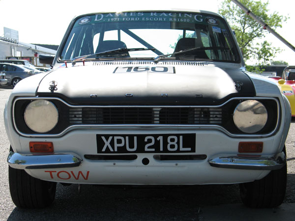 Ford Escort Mk1: Coke bottle styling and a dog bone grille.