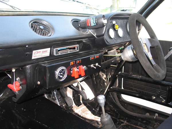 Switches (left to right): battery disconnect, fuel pump, ignition, starter (pushbutton), lights, wipers.