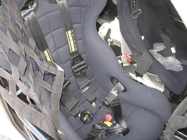 Schroth Racing 6-point cam-lock safety harness.
